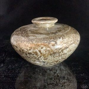 A ceramic vase. Brown, grey and taupe tones.